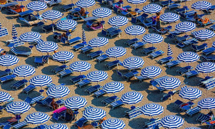 Plenty of Striped Umbrellas on the Beach