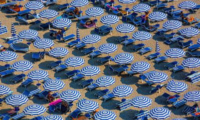 Plenty of Striped Umbrellas on the Beach