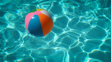 Colorful Beach Ball Floating on Water