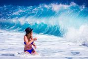 Wet Woman in Blue Bikini at the Sea and Splash of Waves