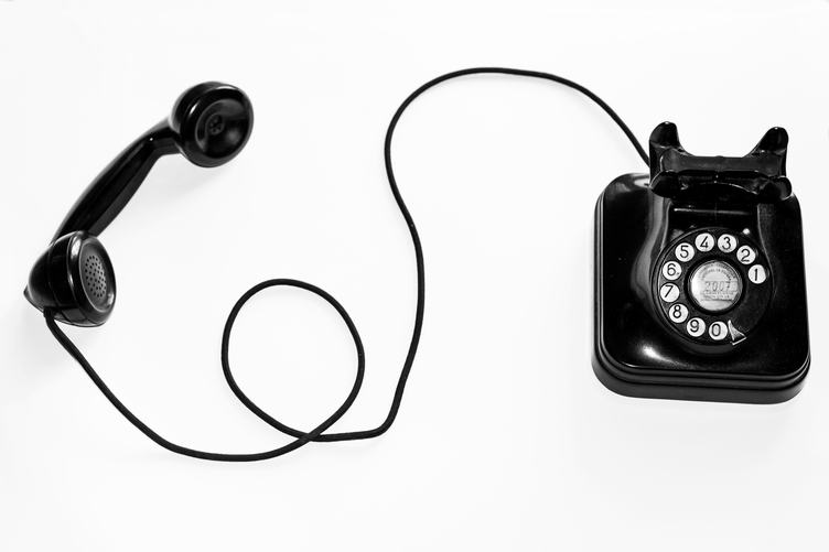 An Old Black Telephone with Rotary Dial Plate