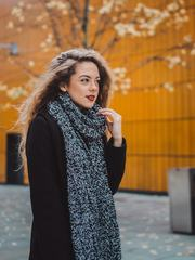 Long Haired Woman Walking at Autumn Street Wearing Black Coat and Scarf