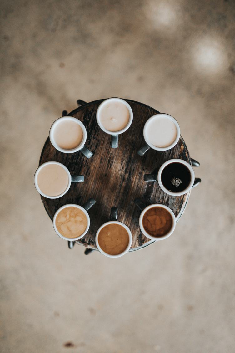 Eight Kinds of Coffee on a Round Wooden Table