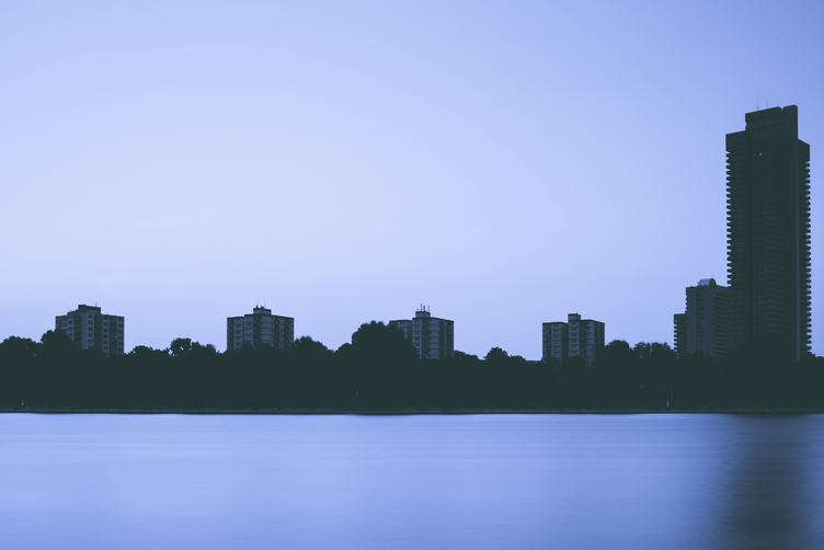 Silhouette of Buildings Near River