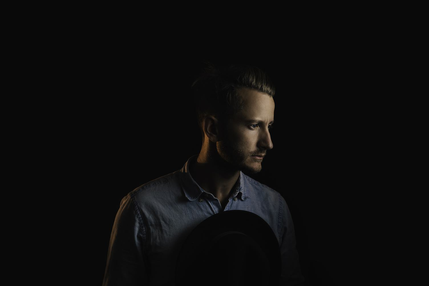 Pensive Man Profile Portrait on Dark Background