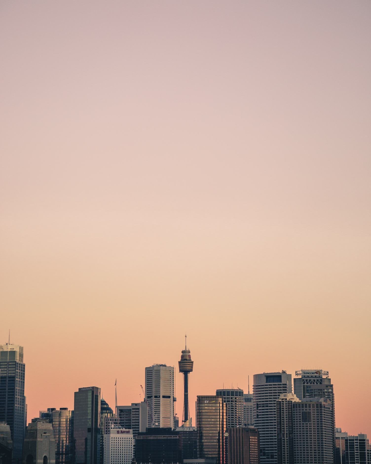 Sydney Business District Skyline with Eye Tower in Orange Tint