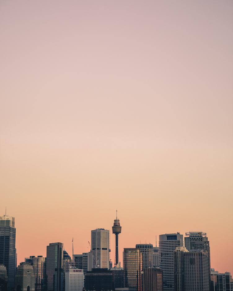 Sydney Business District Skyline with Eye Tower in Orange Tint