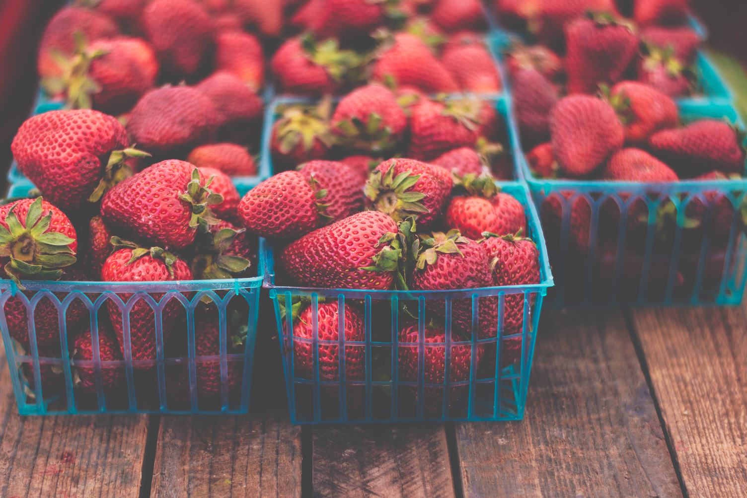 Fresh Strawberries in Boxes on Wooden Table
