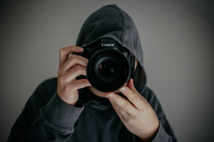 Guy in the Hood with Canon DSLR Camera