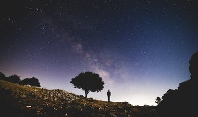 Man Watching the Amazing Starry Sky at Night