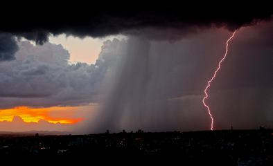 Evening Storm with Lightning over the City