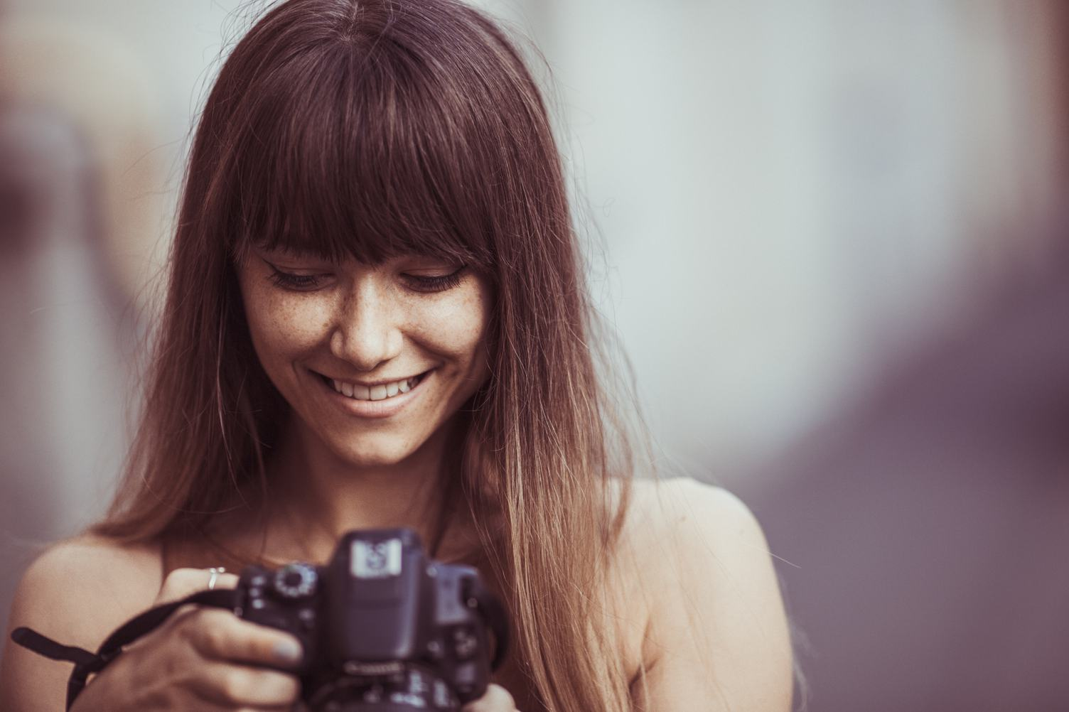 Pretty Woman Is Browse Photos on Her DSLR Camera