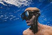 Man with Mask Diving in Clear Water