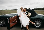 Just Married Couple Together in Black Vintage Car