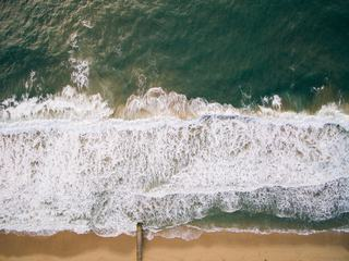 Aerial View of  Ocean with Waves and Sand