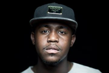 Portrait of Young Man with Cap On Black Background