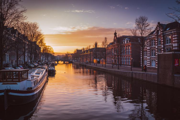 Houses and Boats near Amsterdam Canal at Sunrise