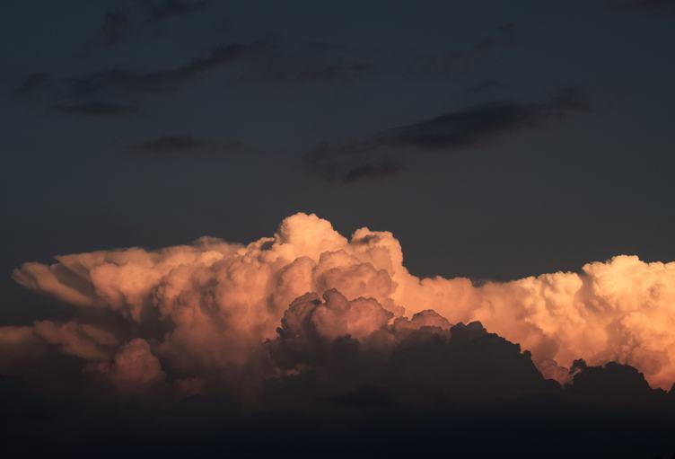 Cumulus Clouds against Dark Sky
