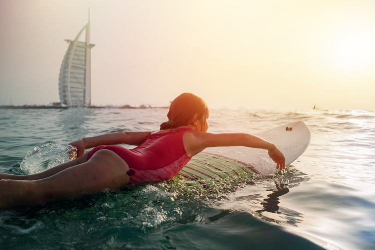 Little Girl Surf against Burj al Arab Building, Dubai