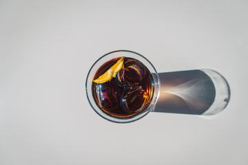 Cola in Glass with Ice Top View