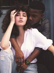 Portrait of Young Man Embracing His Girlfriend from behind