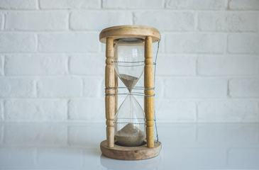 Wooden Hourglass against White Wall