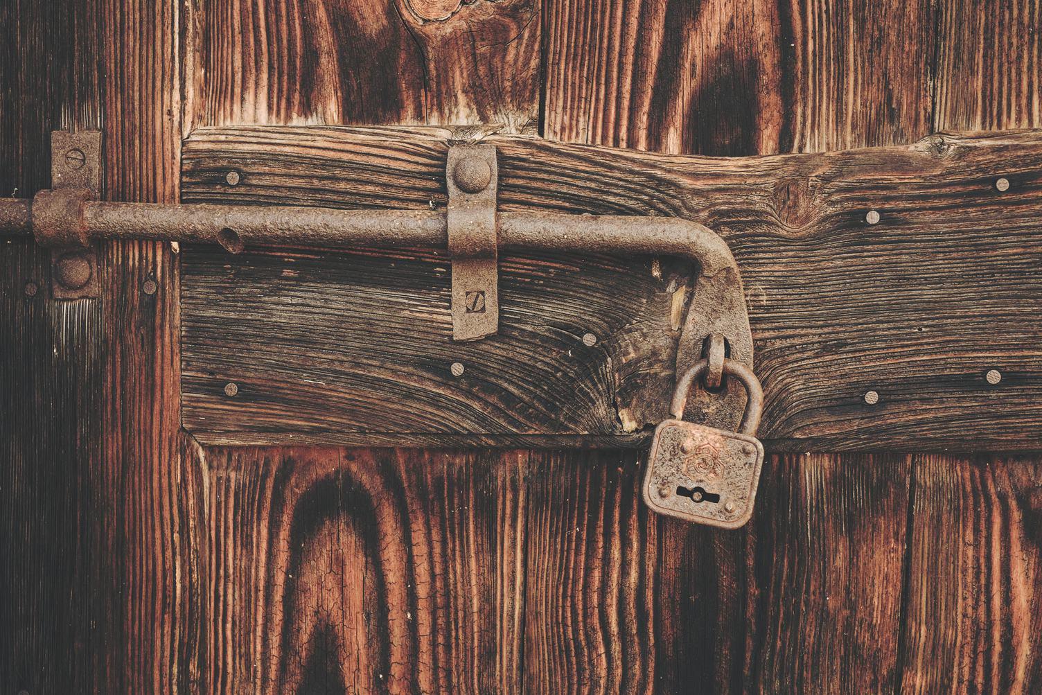 Old Wooden Door with Rusty Latch