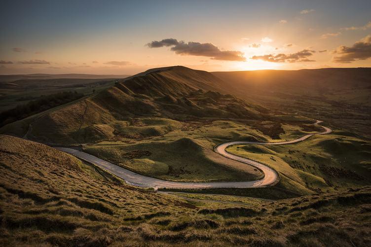 Winding Road Passing Through Green Hills at Sunset, Castleton, UK