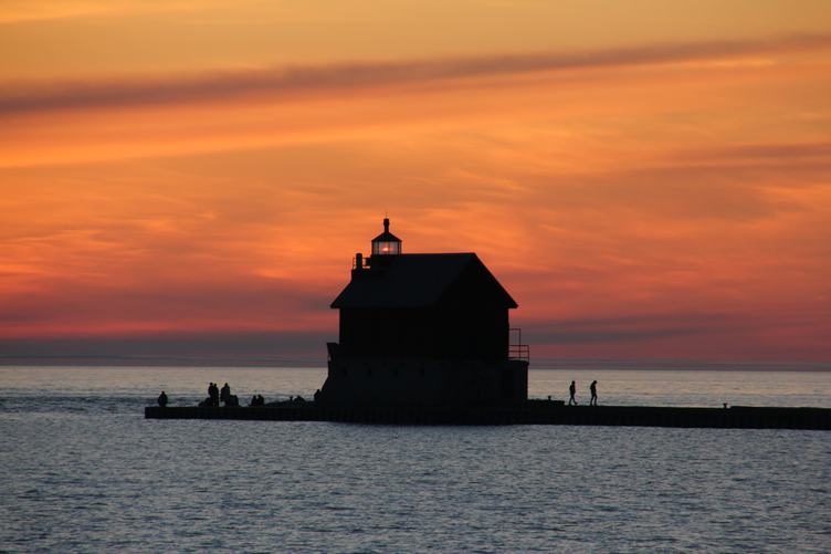 Lighthouse Seen from a Beach at Sunset