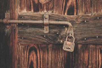 Old Wooden Door with Rusty Latch