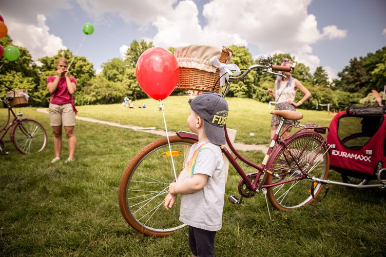 Little Boy with Red Balloon in Park