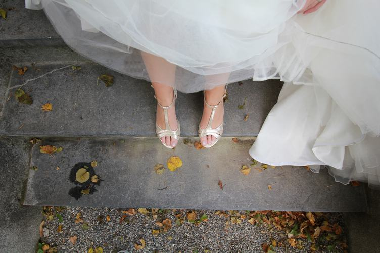Bride Standing on Stairs Closeup of Legs