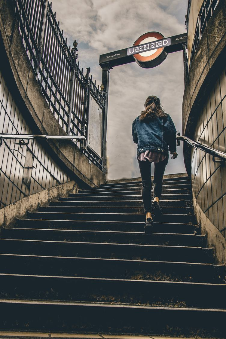 Woman Steps up the Stairs from the Subway Station, London