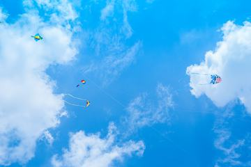 Kite and Parachute on Blue Sky
