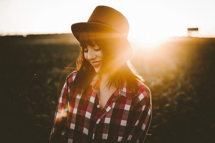 Smiling Brunette in Checkered Shirt