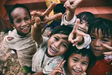 A Group of poor Vietnamese Children Smiling