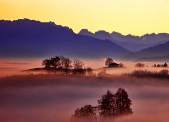 Misty Mountains Landscape with Building and Trees