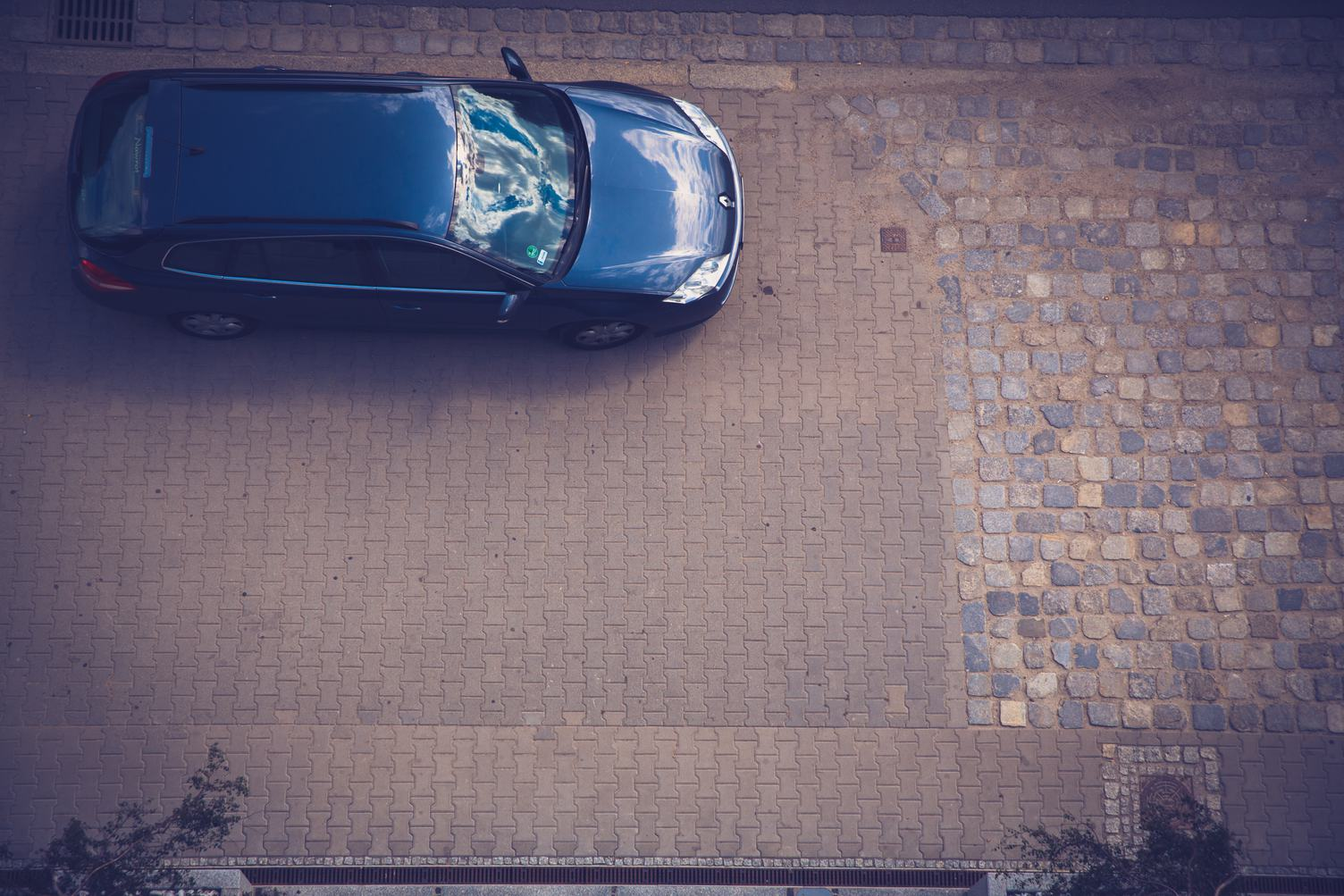 Car Parked on the Sidewalk View from Above