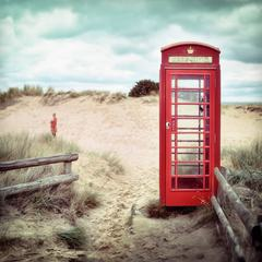 Retro English Red Phone Box on the Beach