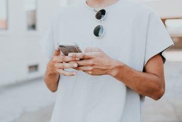 Man Holding iPhone in Hands