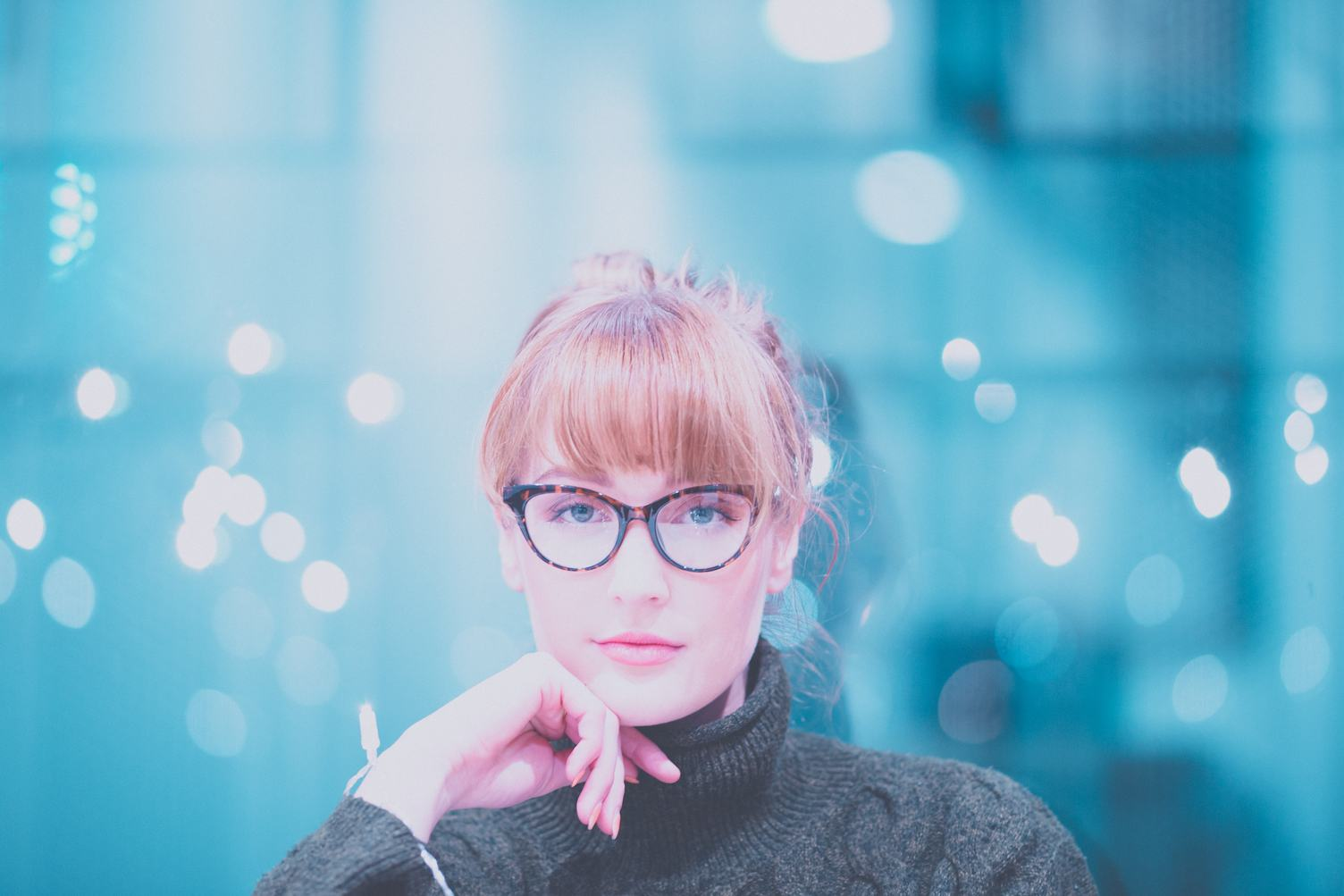 Woman Wearing Glasses and Gray Jumper
