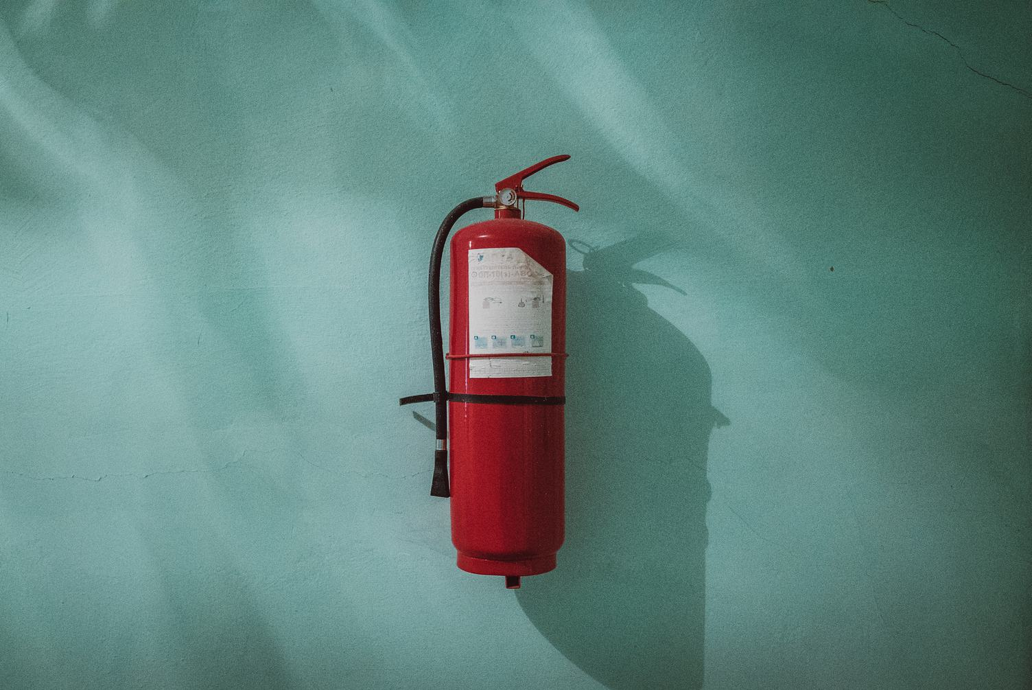 Fire Extinguisher on the Celadon Wall