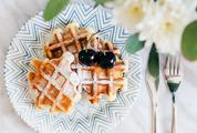 Fresh Belgian Waffles Sprinkled with Powdered Sugar