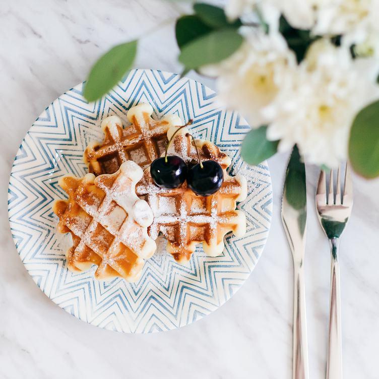 Fresh Belgian Waffles Sprinkled with Powdered Sugar