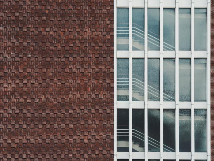 Brown Building Facade with Windows