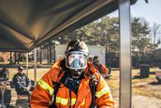 Portrait of Young Firefighter Wearing Mask