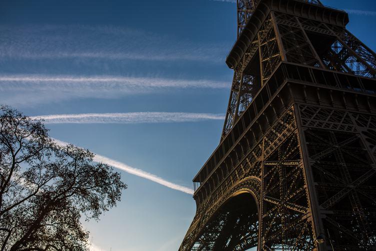 Closeup of Eiffel Tower against Blue Sky