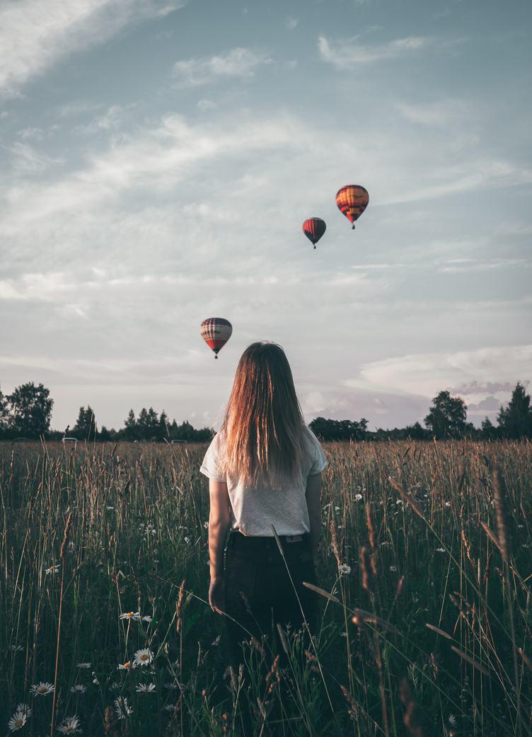 Girl looking at Three Colorful Hot Air Balloons