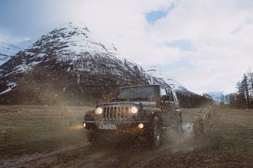Off Road Expedition Jeep Splashing Mud