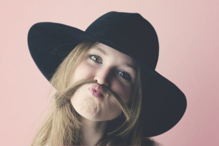 Portrait of Young Girl with Moustache Made of Hair